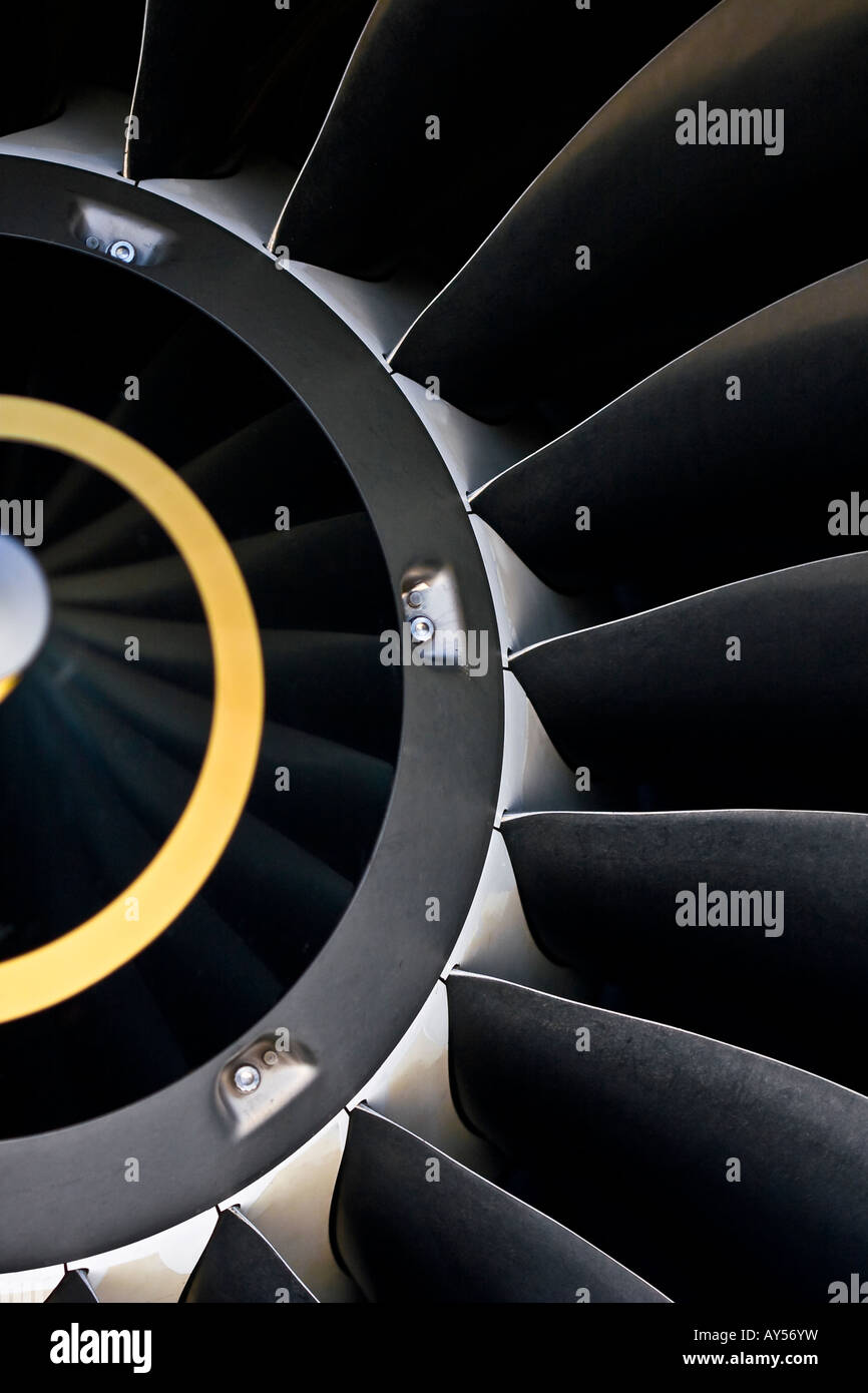 Closeup of the air inlet of an IAE V2500 turbofan engine showing the metal texture on the fan blades. - Stock Image