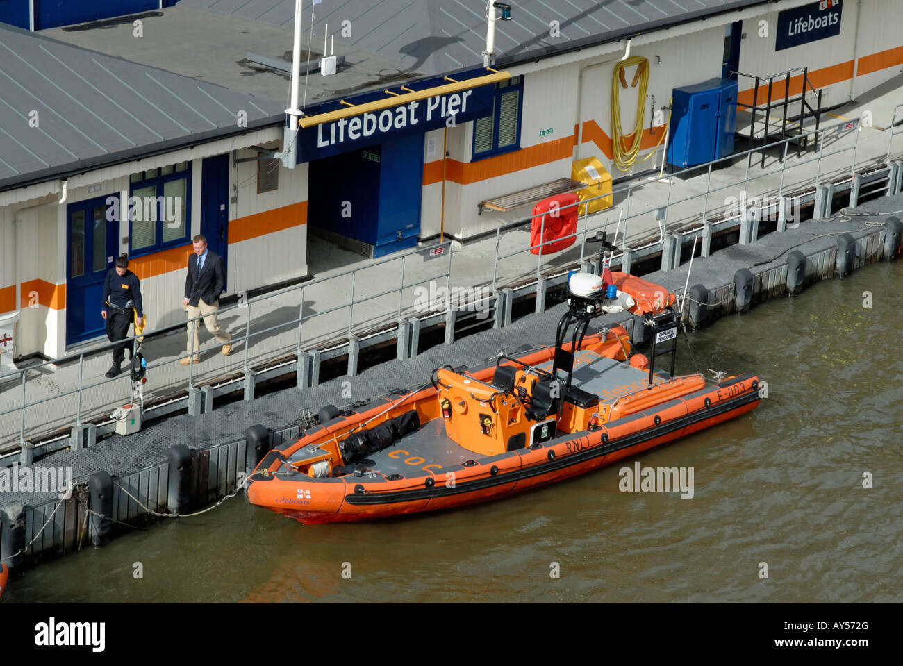 Rescue RIB moored at the RNLI Lifeboat Pier on the River Thames, Victoria Embankment, London, England Stock Photo
