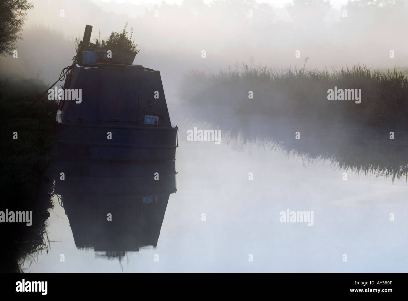 Doug Blane Moored narrowboat on a mysty noring on the Oxford CanalStock Photo