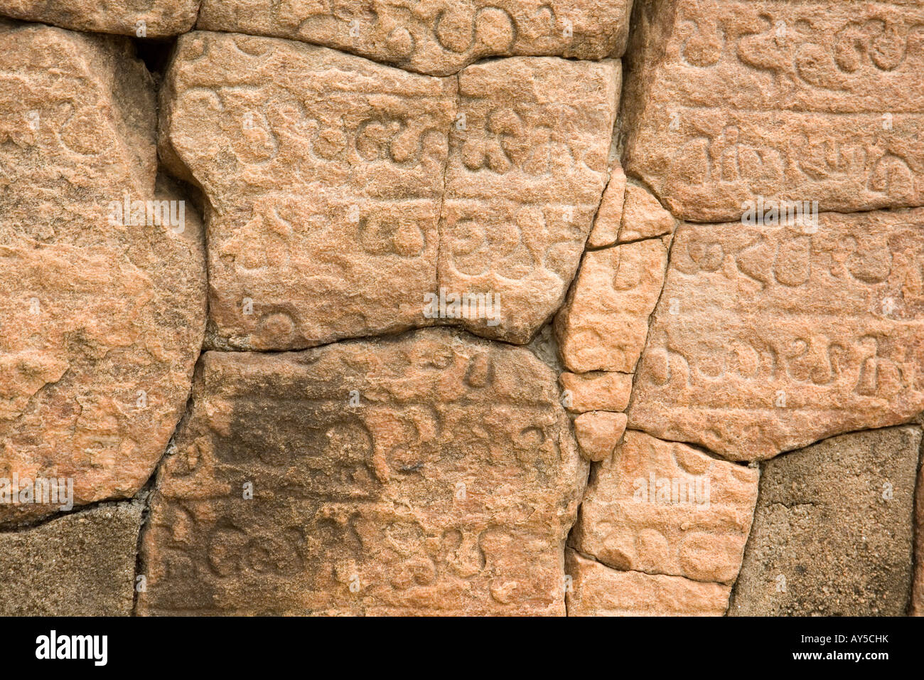 scripture in a wall of ancient temple in Polonnaruwa - Stock Image
