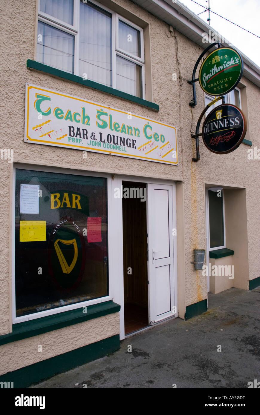Doochary County Donegal Ireland Sign in Gaelic at a bar in the town - Stock Image