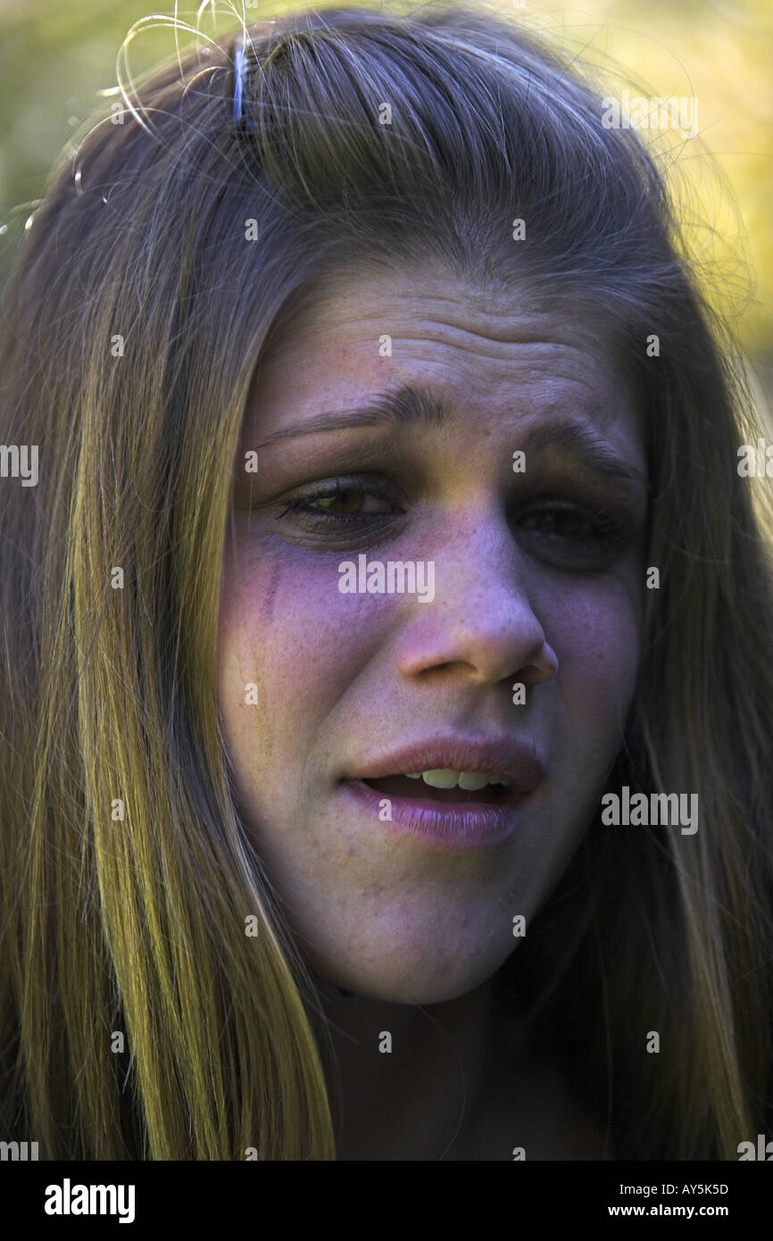 Young girl looking very upset and tearful - Stock Image