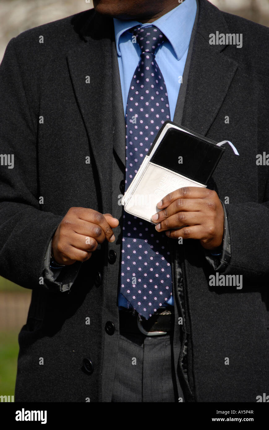 Close up of born again evangelical Christian preacher with Bible at Speaker s Corner London - Stock Image