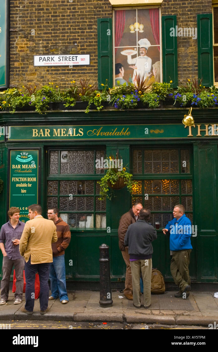 People outside a pub during lunch hour in the borough of Southwark in London UK - Stock Image