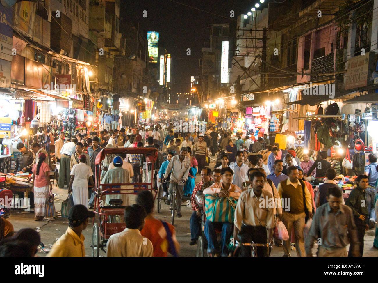 Main street in Paharganj with market and bazaar in Delhi in India - Stock Image