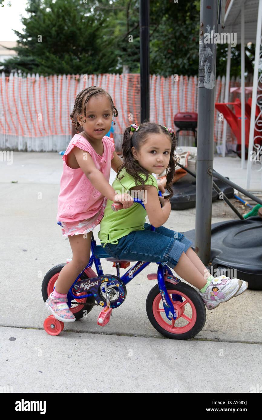 Nursery school children playing on the playground in