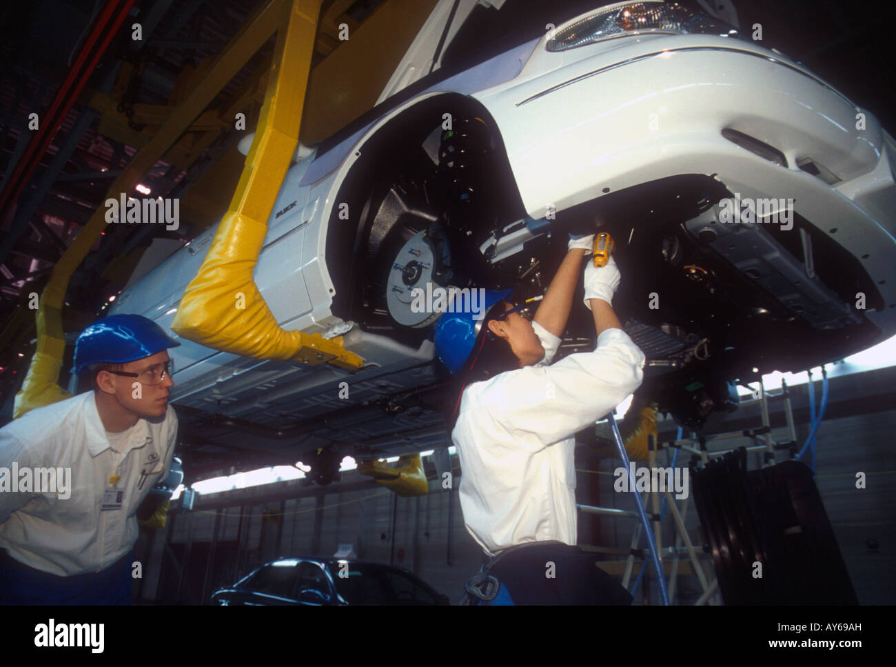 Shanghai GM Buick assembly line with Chinese woman worker and American male supervisor in 1999 - Stock Image
