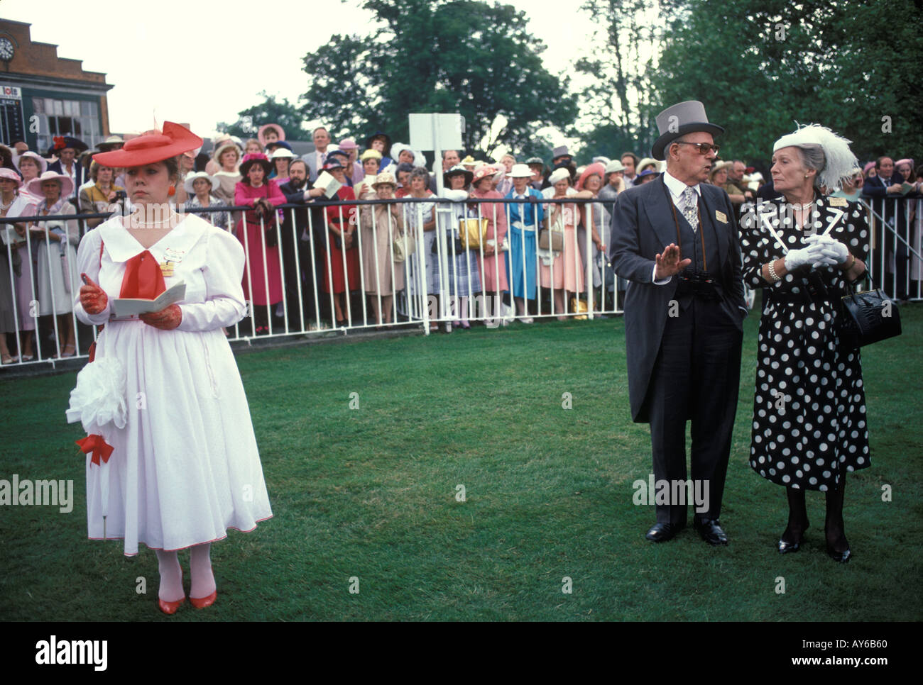 Royal Ascot Horse races racing Berkshire  England. Circa 1985. fashionable woman in white dress HOMER SYKES - Stock Image
