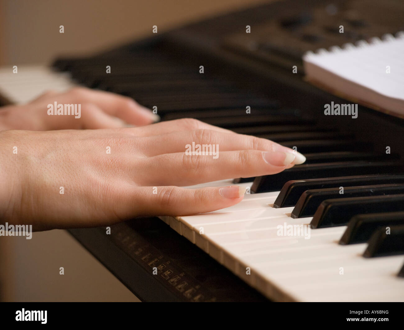 Pianist's hands playing synthesiser - Stock Image