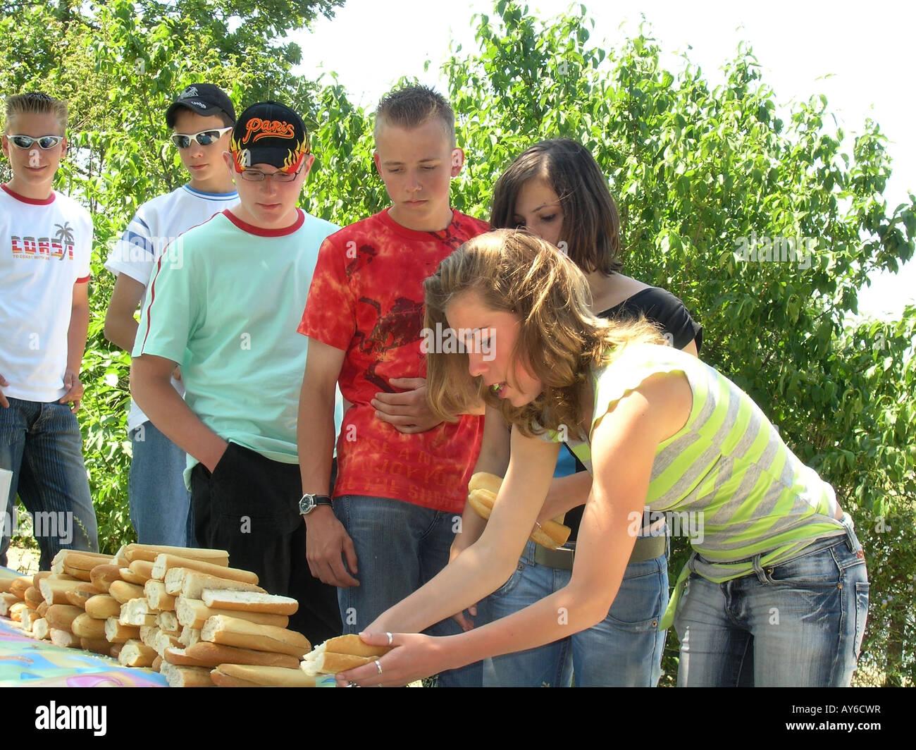 Group of schoolkids enjoying picnic in Bois de Boulogne Paris France - Stock Image