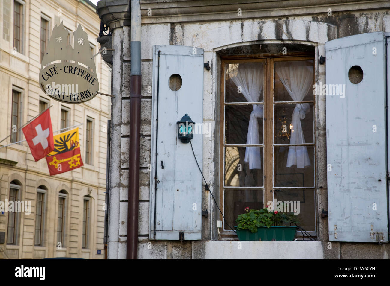 Window of cafe creperie with shutters in the old town area of Geneva - Stock Image