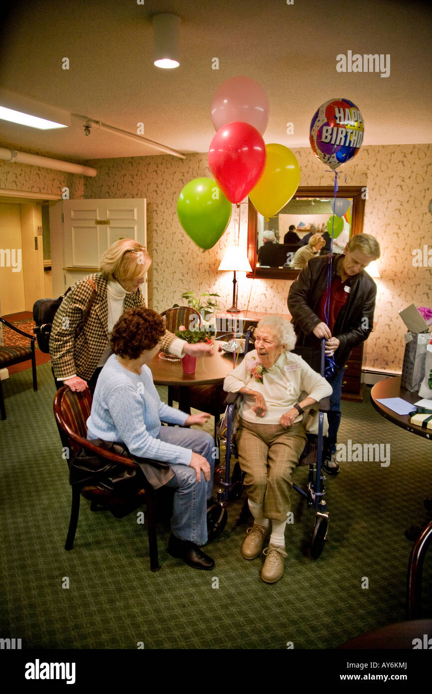 Well wishers say goodbye to a centenarian after her 100th birthday party at a nursing home in Stoneham MA - Stock Image