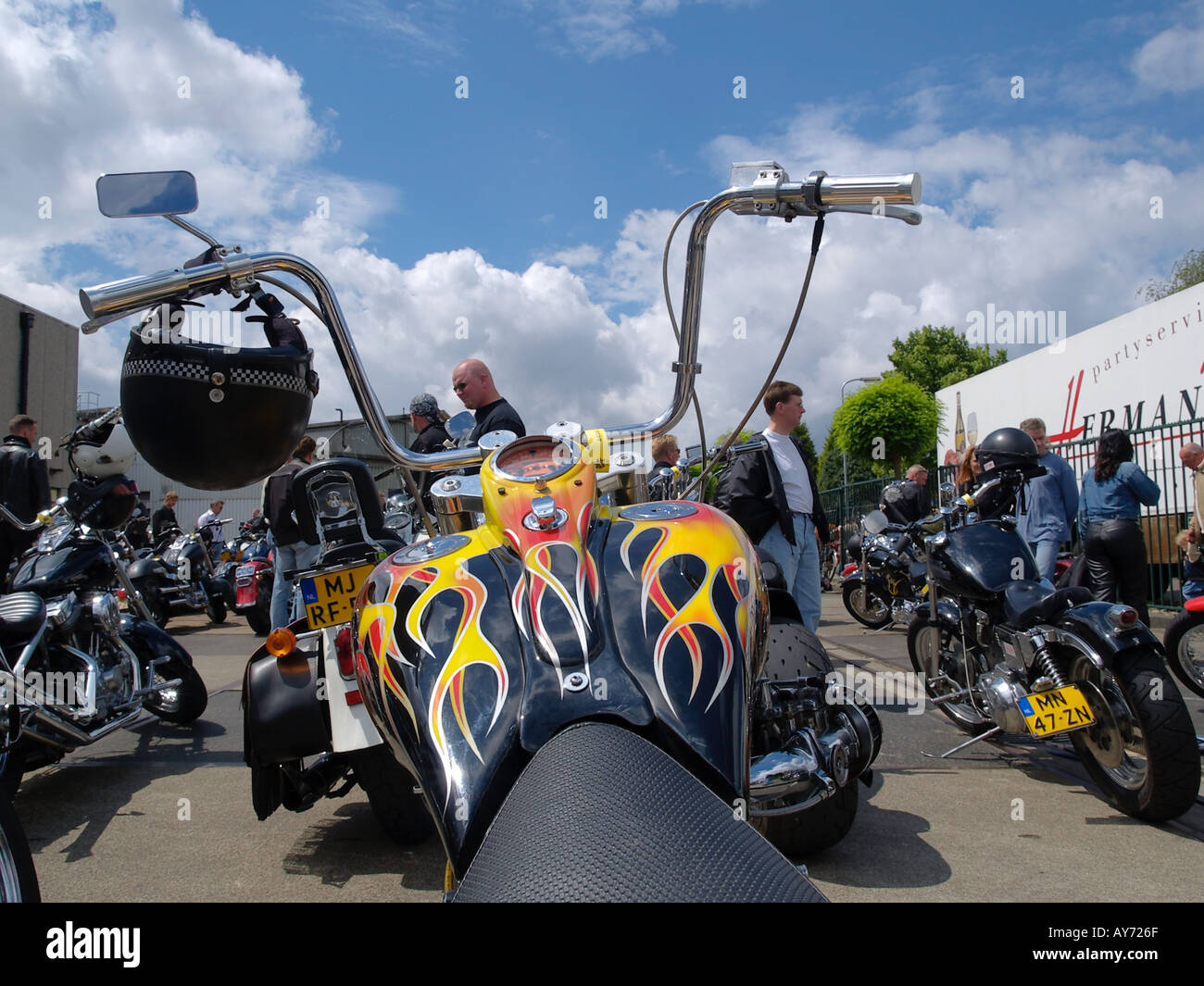 Custom Built Harley Davidson Motorcycle With Flame Paint Job And Super High Apehanger Handlebars Photographed At