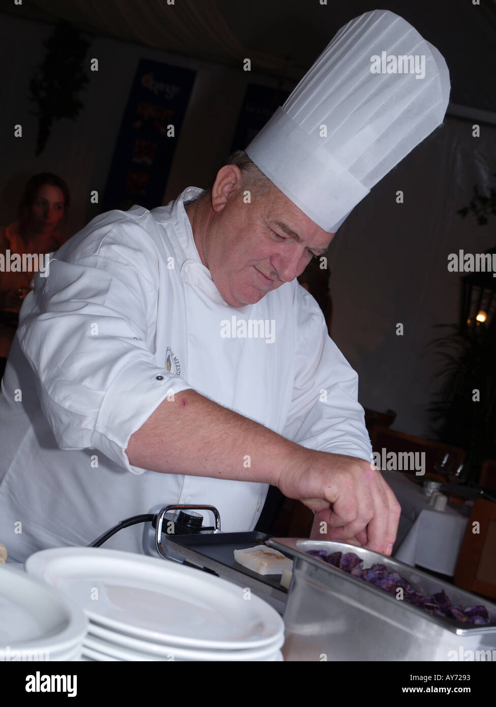 Famous Dutch TV chef Cas Spijkers at work - Stock Image