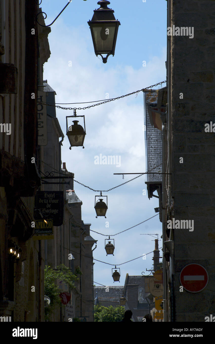 Lights hanging across street in French medieval town of Dinan Stock Photo