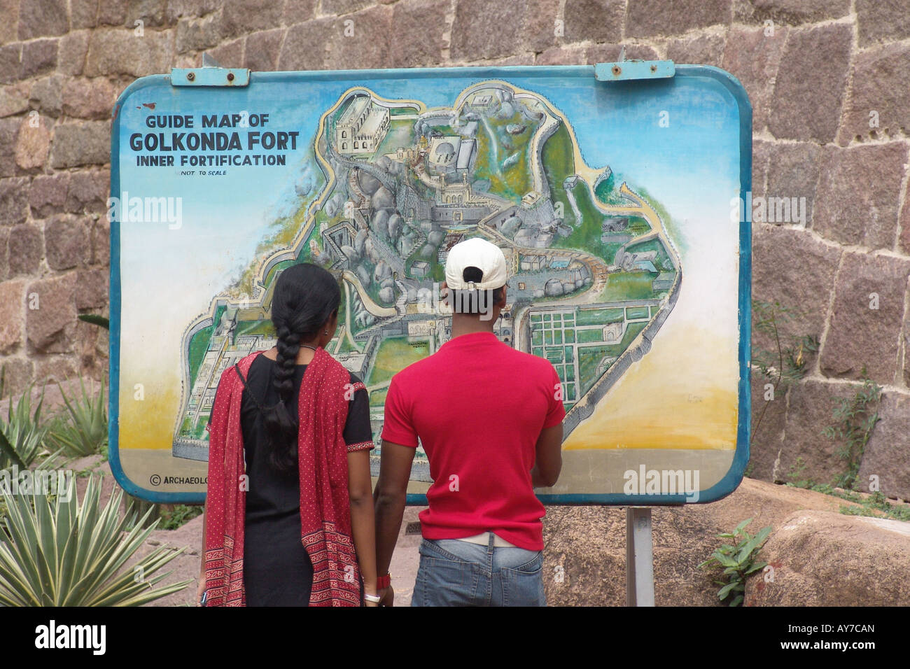 A young couple watching the Golconda fort map, Hyderabad ... on hindu kush map, hampshire map, lebanon map, khyber pass map, la salle map, harvard map, spring creek map, st. charles map, monticello map, elko map, savannah map, belleville map, elmhurst map, boston map, crystal lake map, oak forest map, highland map,