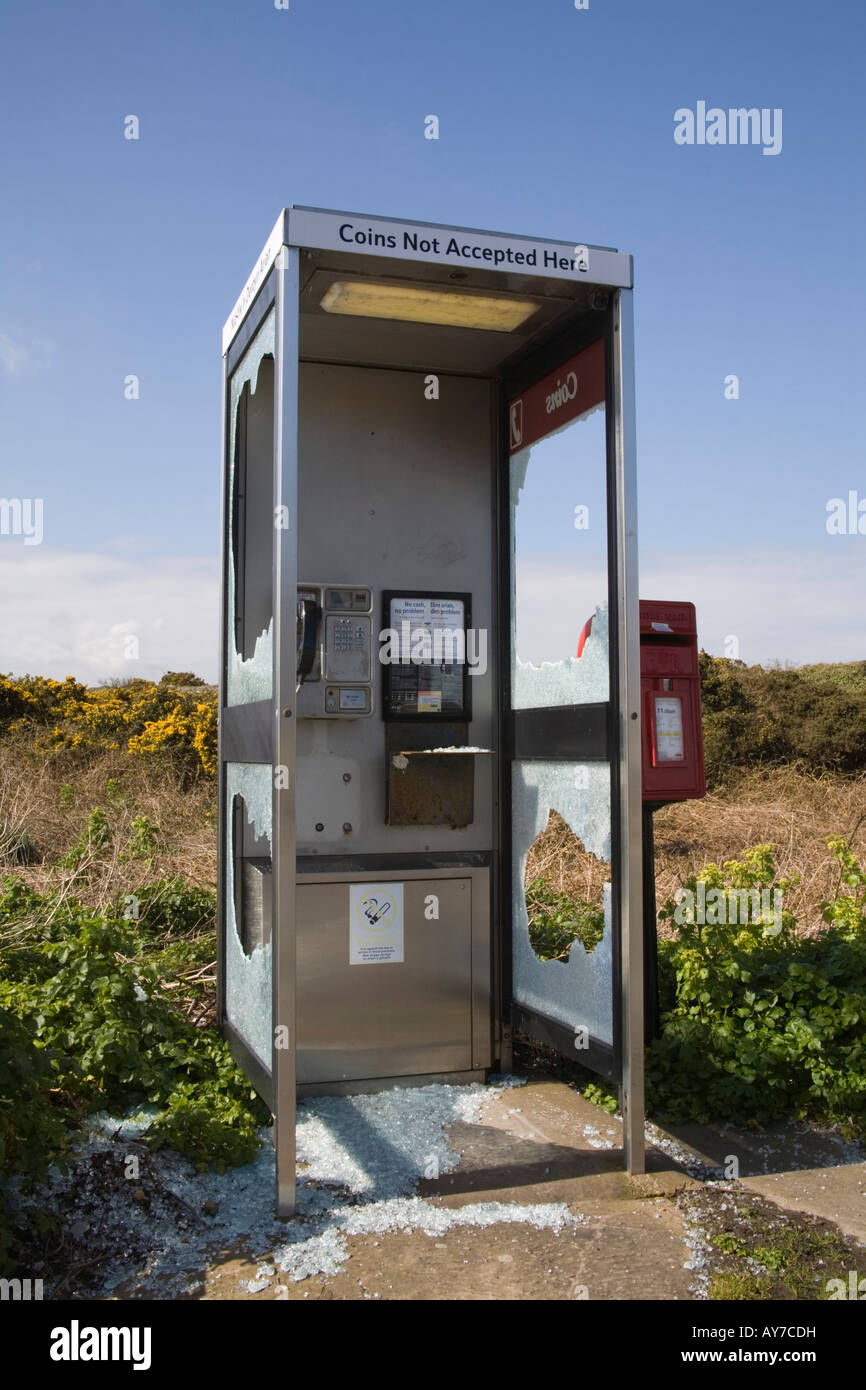North Wales UK March A severely vandalized public telephone box - Stock Image