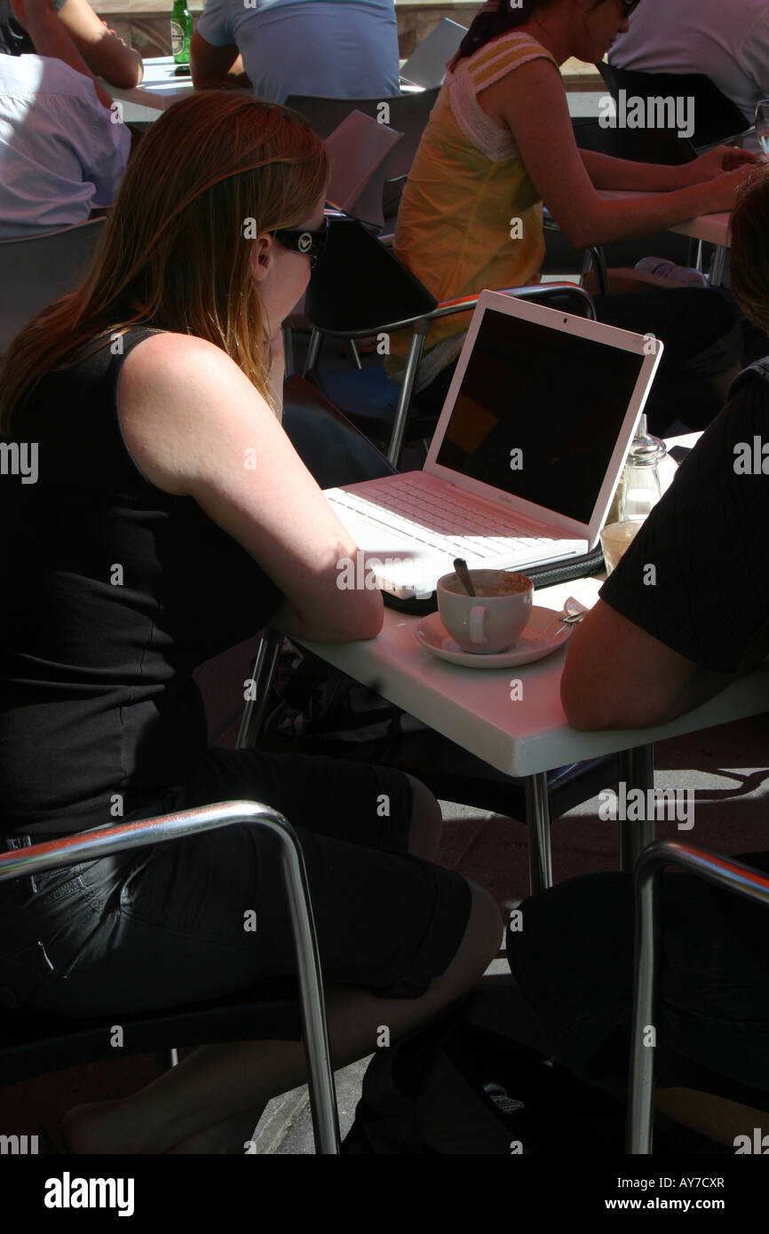 woman using laptop at a cafe in Melbourne - Stock Image