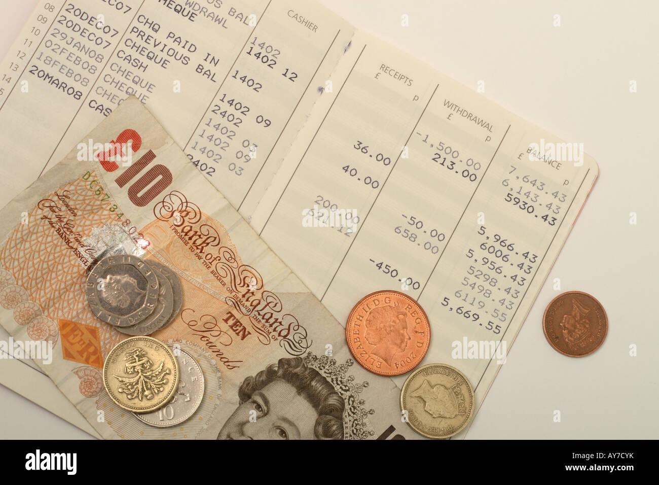 Savings account book building society money cash coin deposit - Stock Image