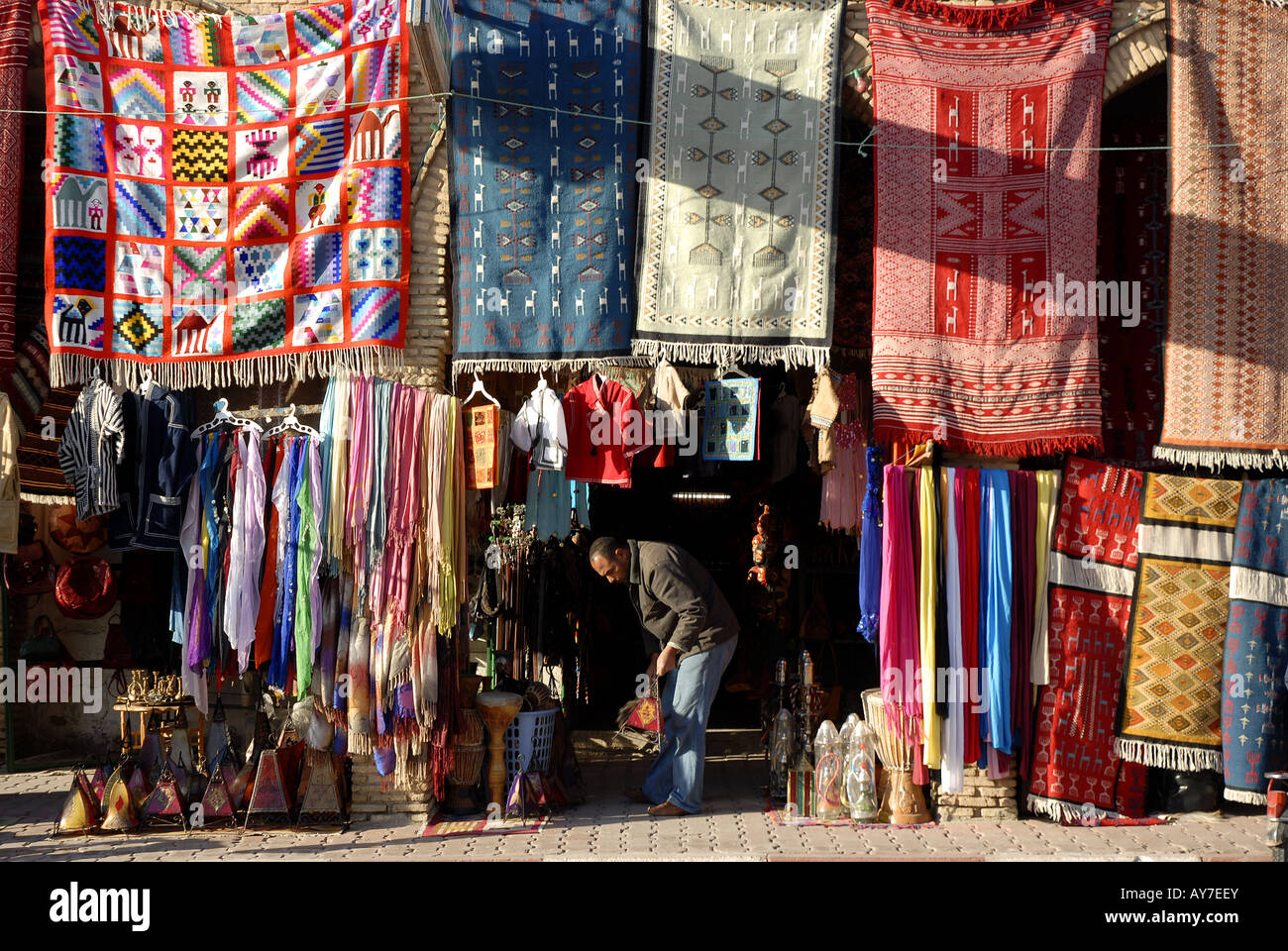 Local Handicrafts Clothes And Carpets In Tozeur Market Tunisia Stock