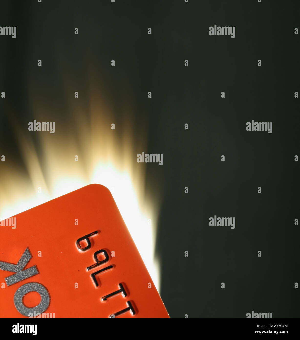 Close-up of burning plastic card. This card is not valid now. - Stock Image