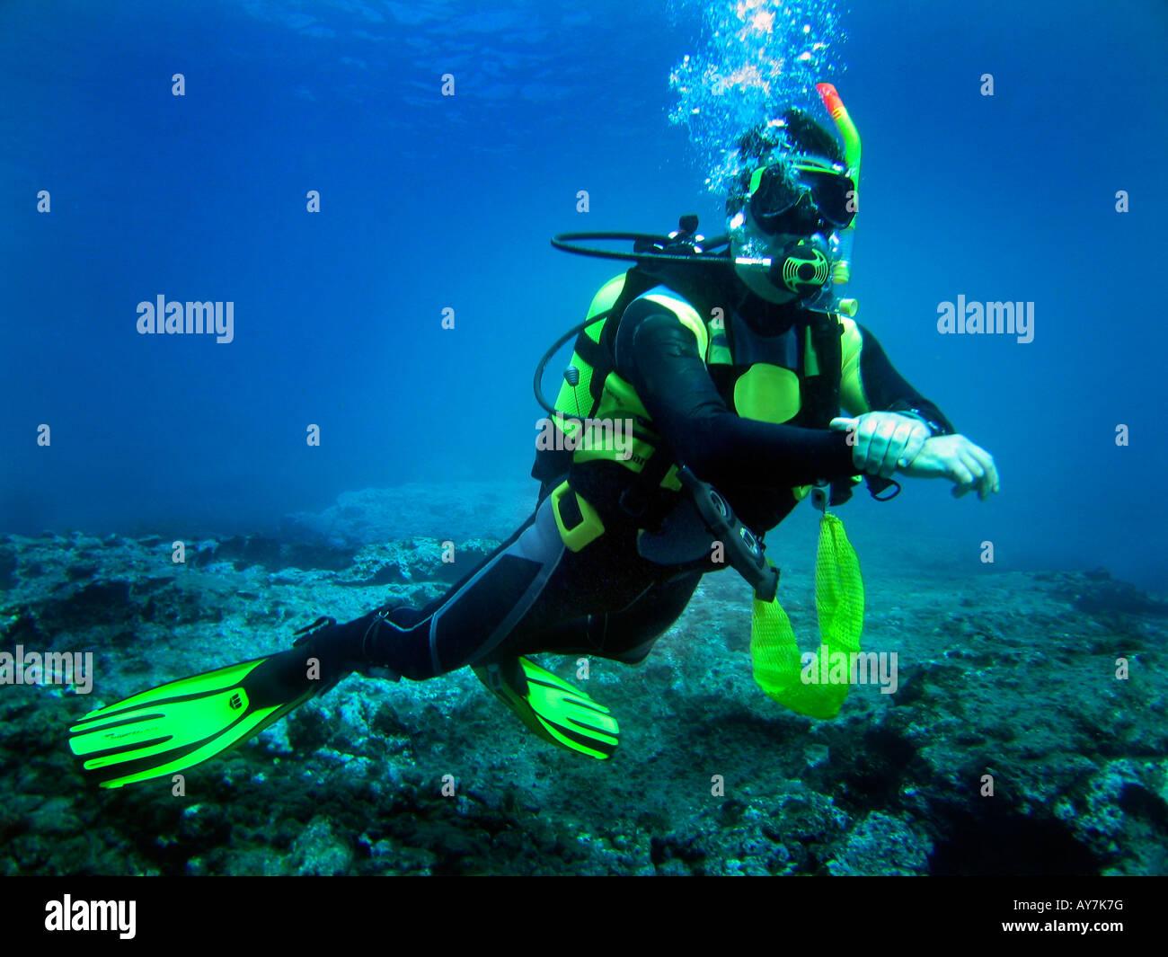 Diver performing underwater buoyancy control - Stock Image