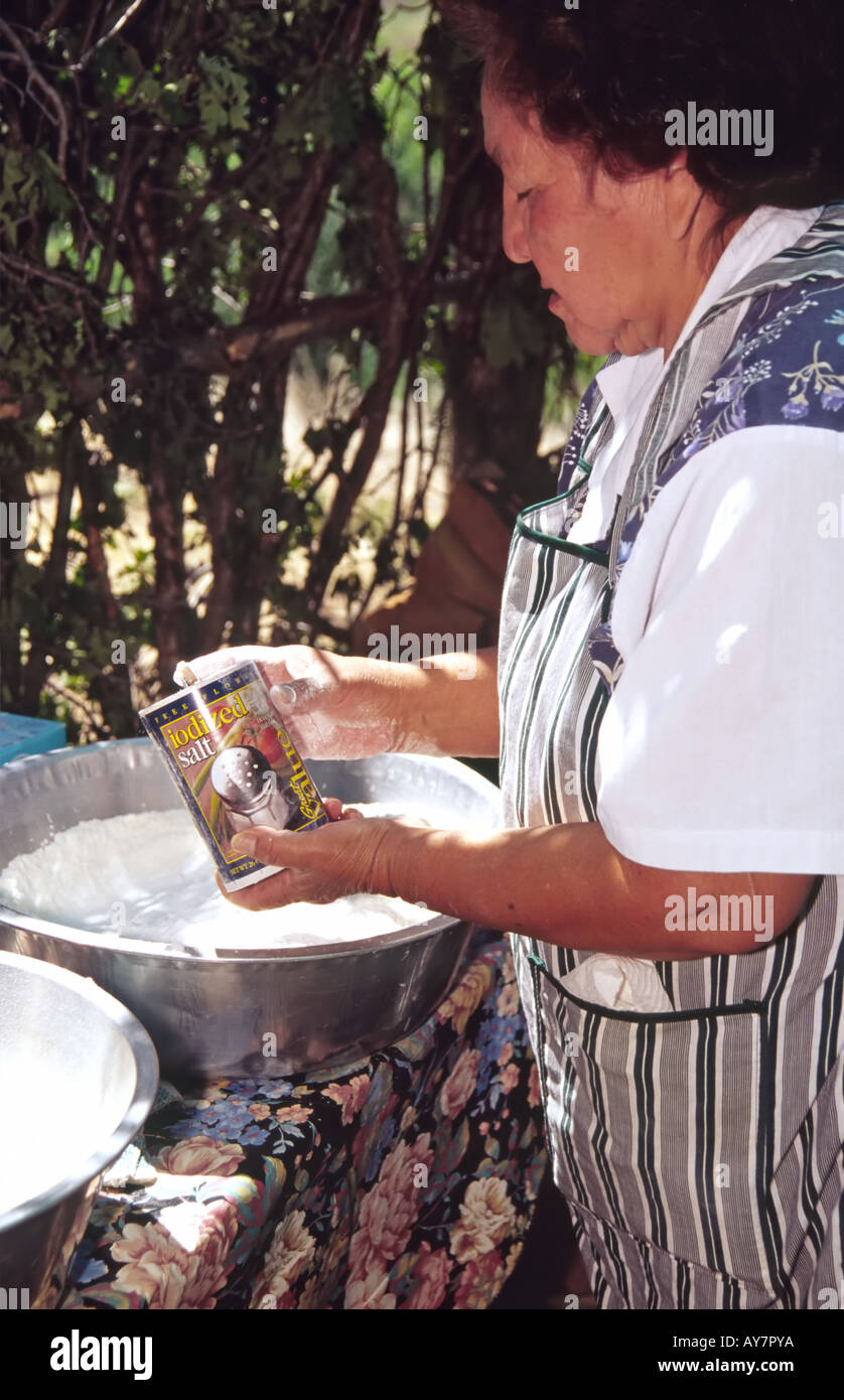 A Native American Mescalro Apache Indian Woman Adds Salt To
