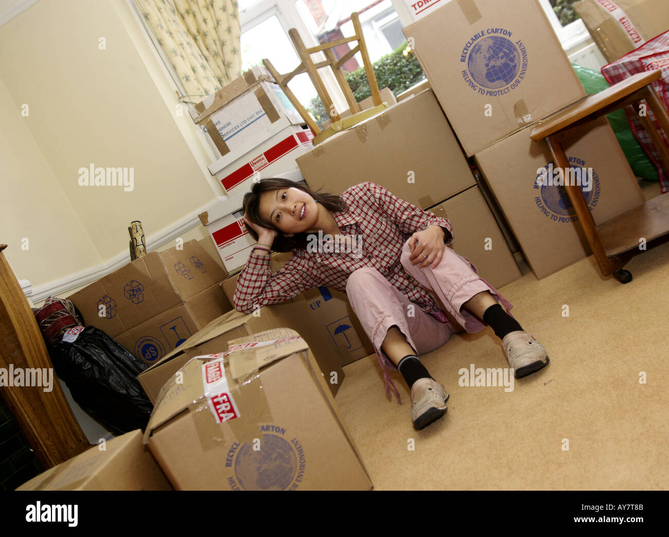 a young woman relaxes happy after move into new home Stock Photo