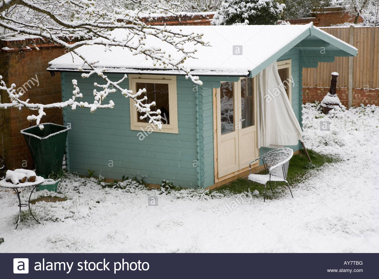 summer house in the snow - Stock Image