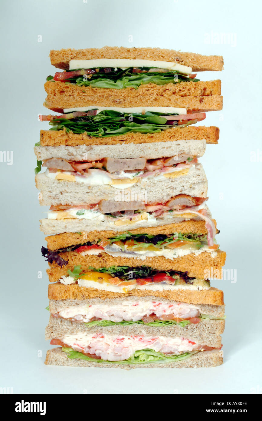 Pile of Sandwiches a selection of fillings on white and brown bread Stock Photo