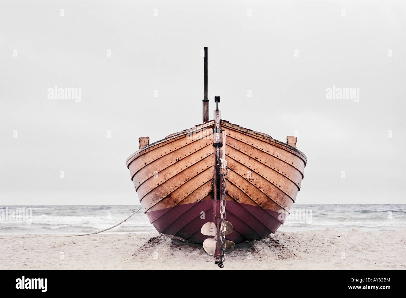 Wooden Fishing Boat On Beach - Stock Image