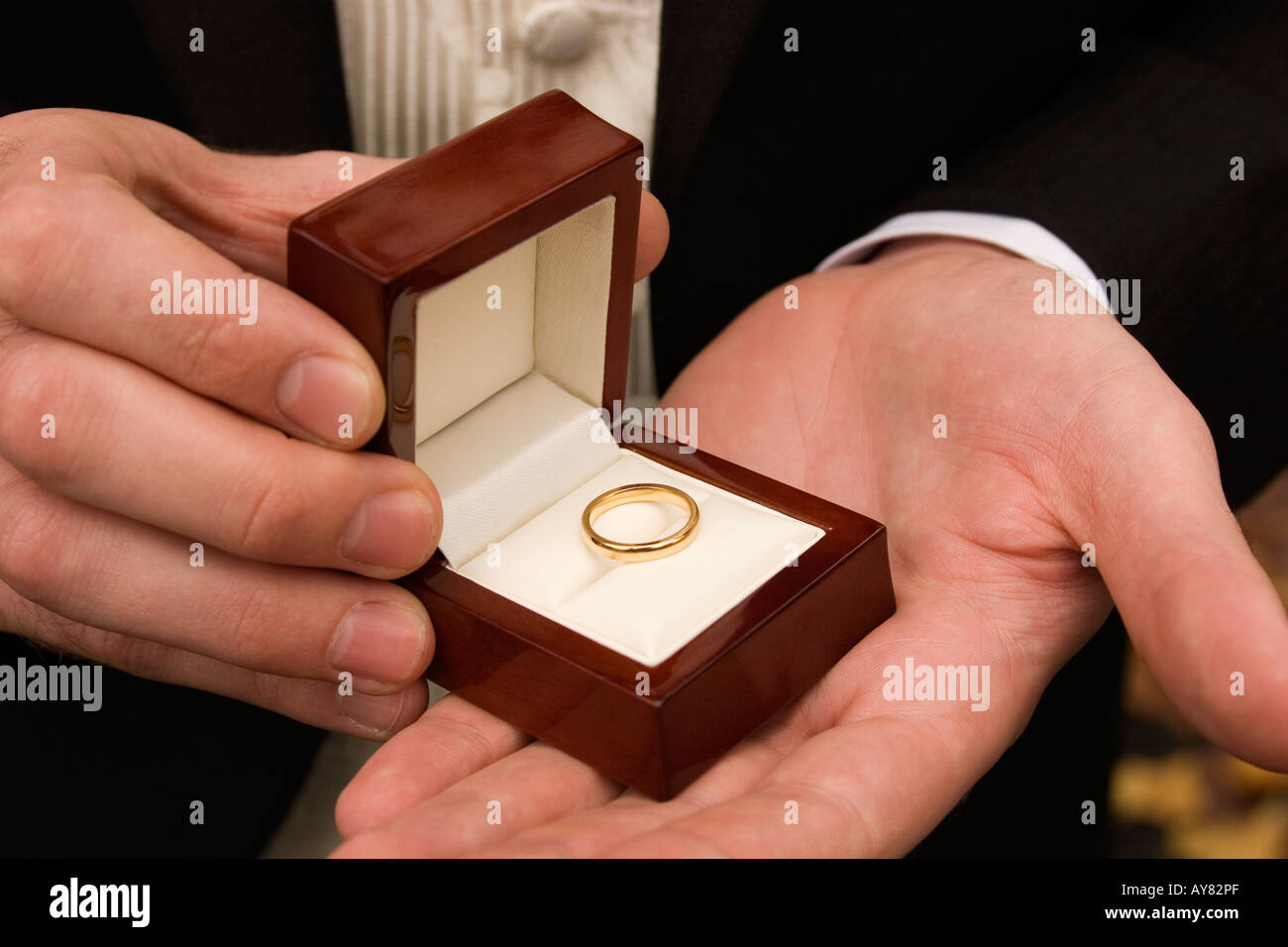 weddings best man holding boxed wedding ring in palm of hand - Stock Image