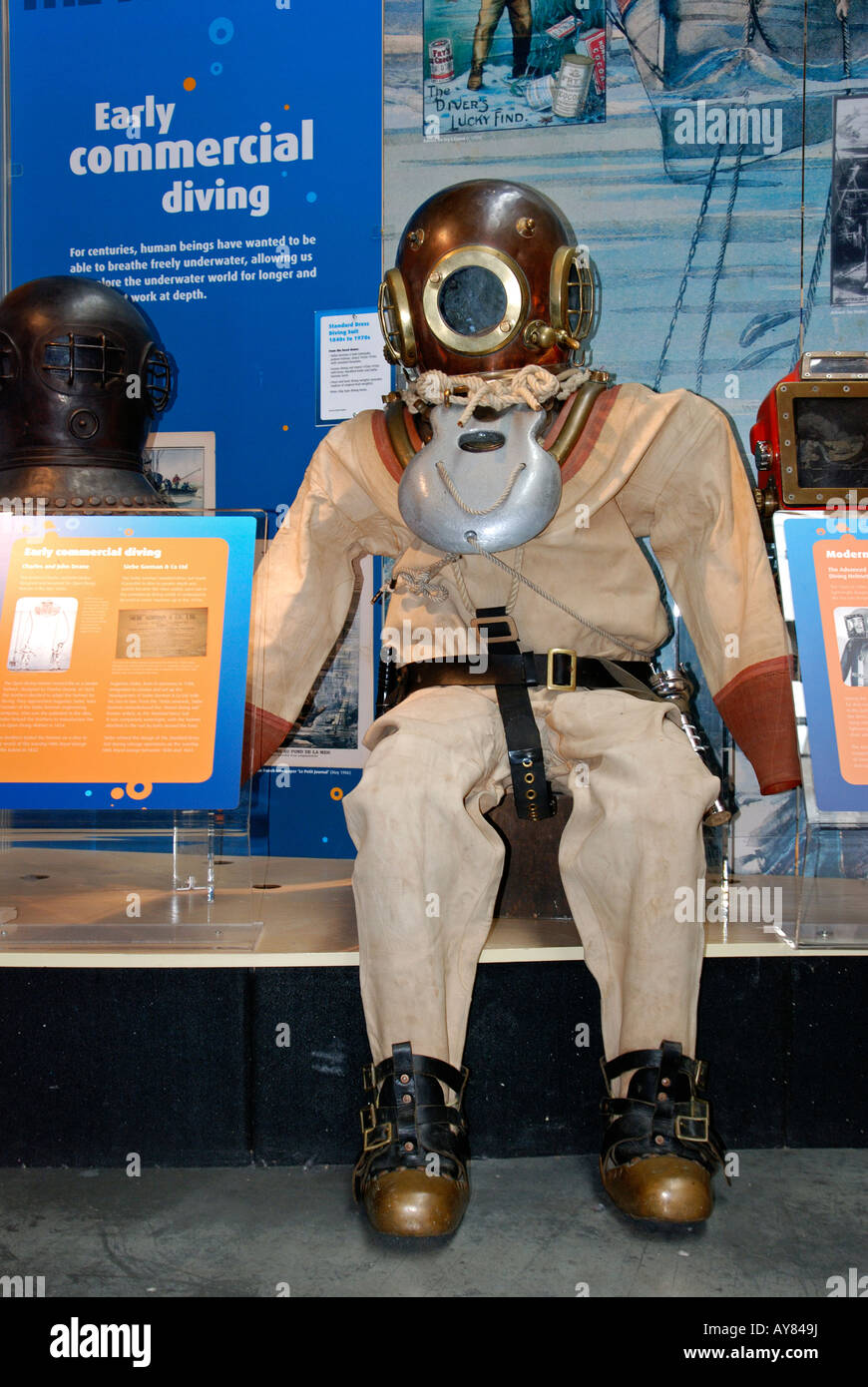an old style deep sea diving suit at an exhibition in the national maritime museum,falmouth,cornwall - Stock Image