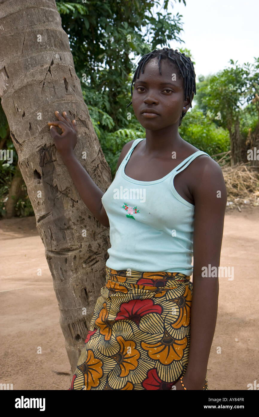 Portrait of a young girl benefitting from a humanitarian aid agencies girls education project in West Africa - Stock Image