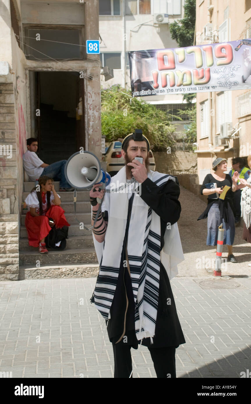 Israel Tel Aviv A Jewish male with a tallith and loudspeaker announcing the next prayer schedule - Stock Image