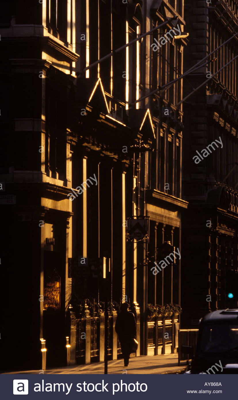 Business man and woman walking down Cornhill in City of London - Stock Image