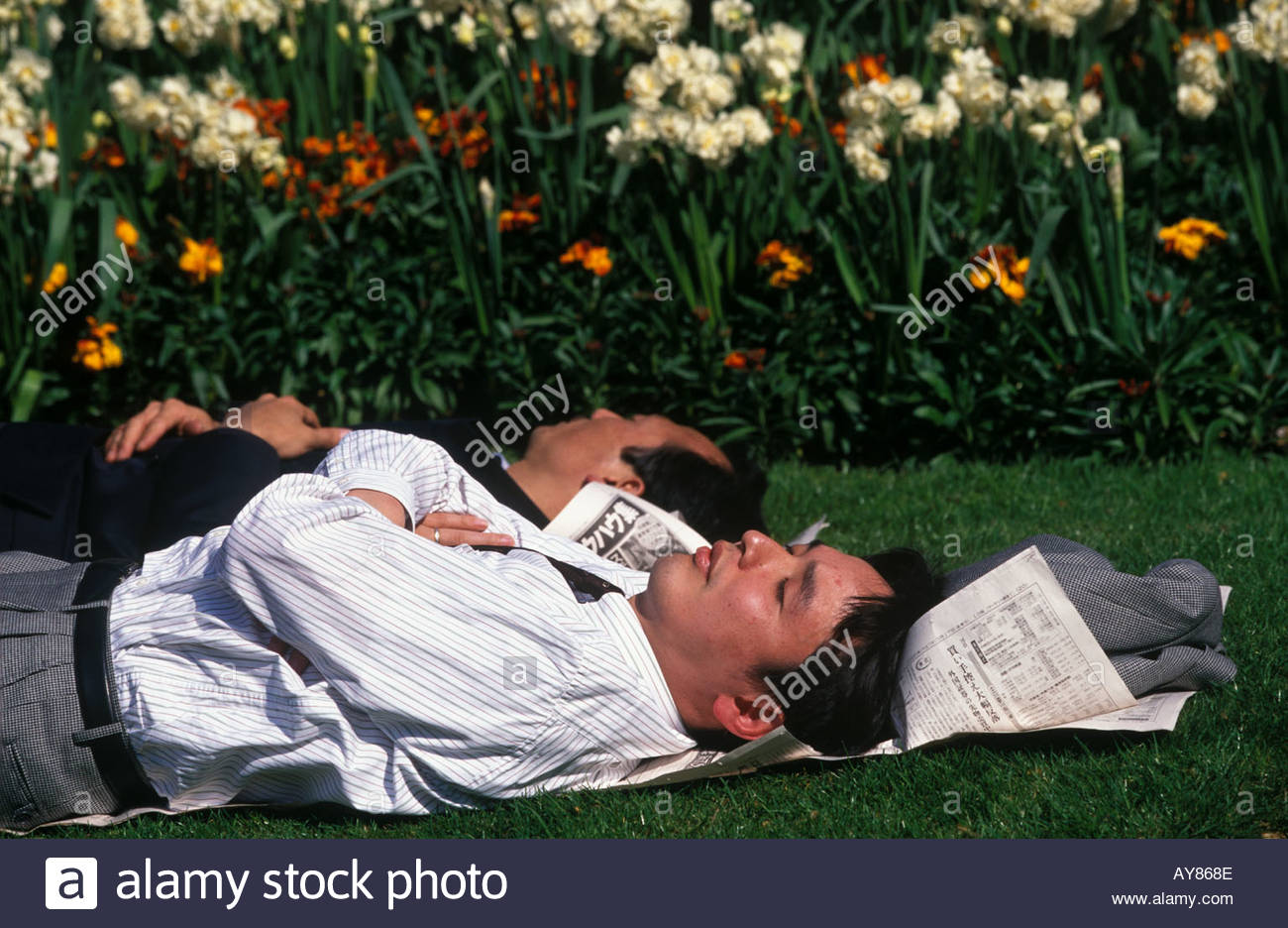 Business men sleeping in Finsbury Circus City of London - Stock Image