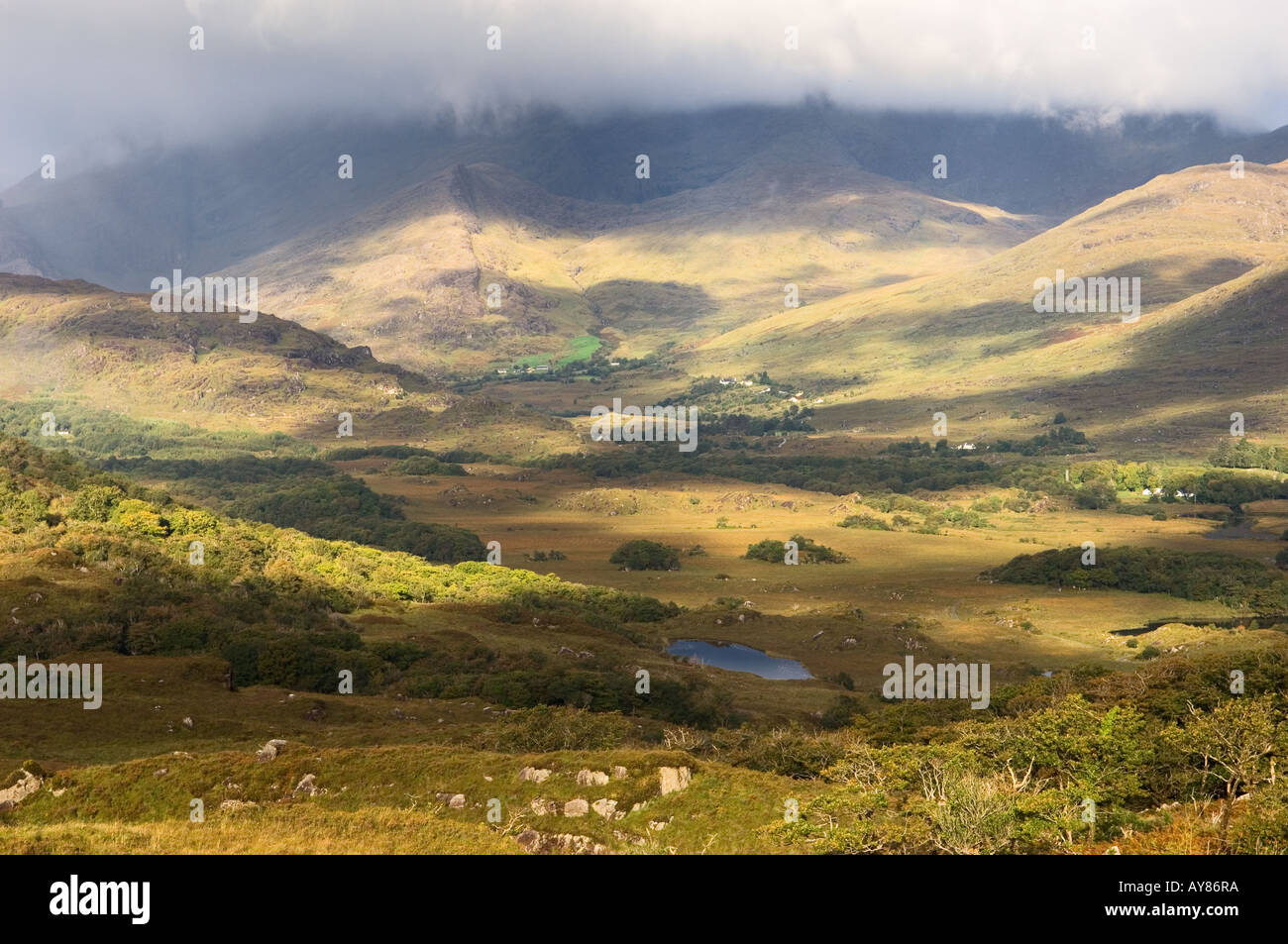 West over hill farms at the head of the valley of the Owenreagh River above the Lakes of Killarney, County Kerry, Ireland. - Stock Image