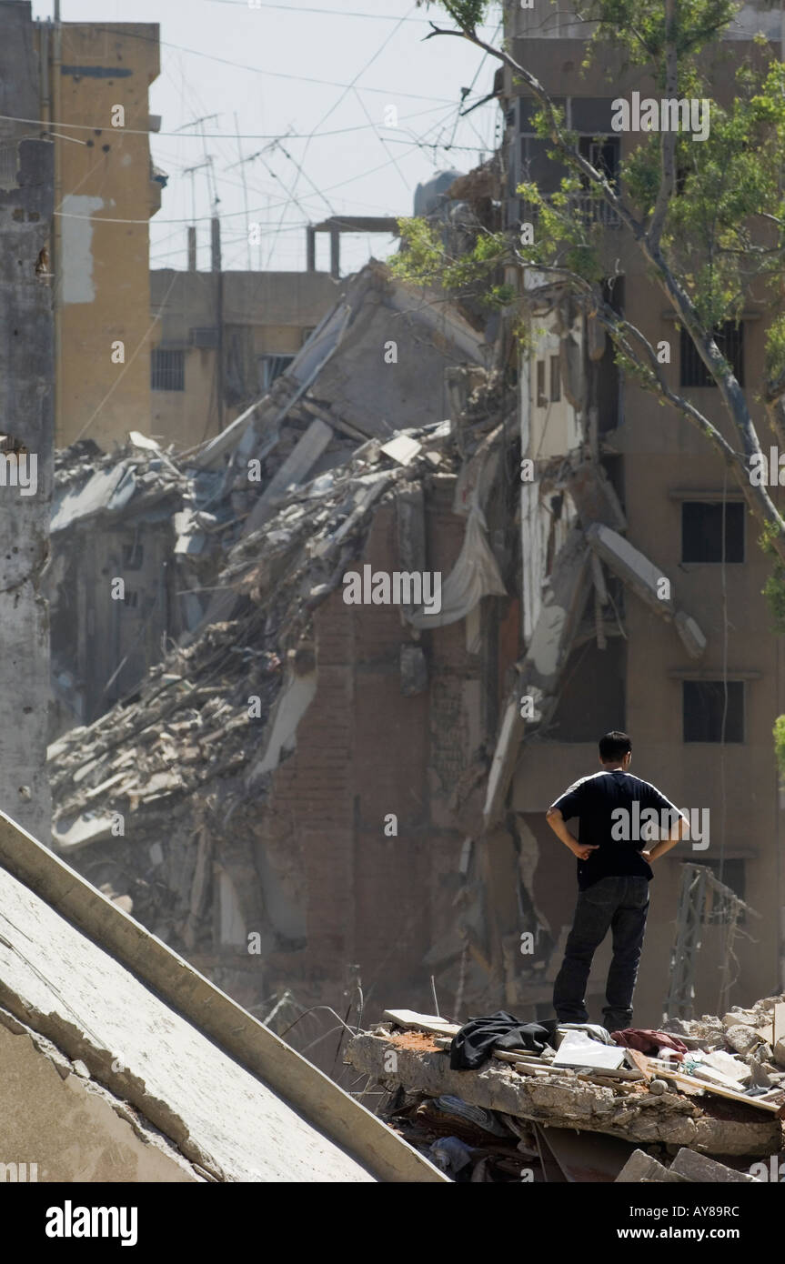 man standing in a destroyed area - Stock Image