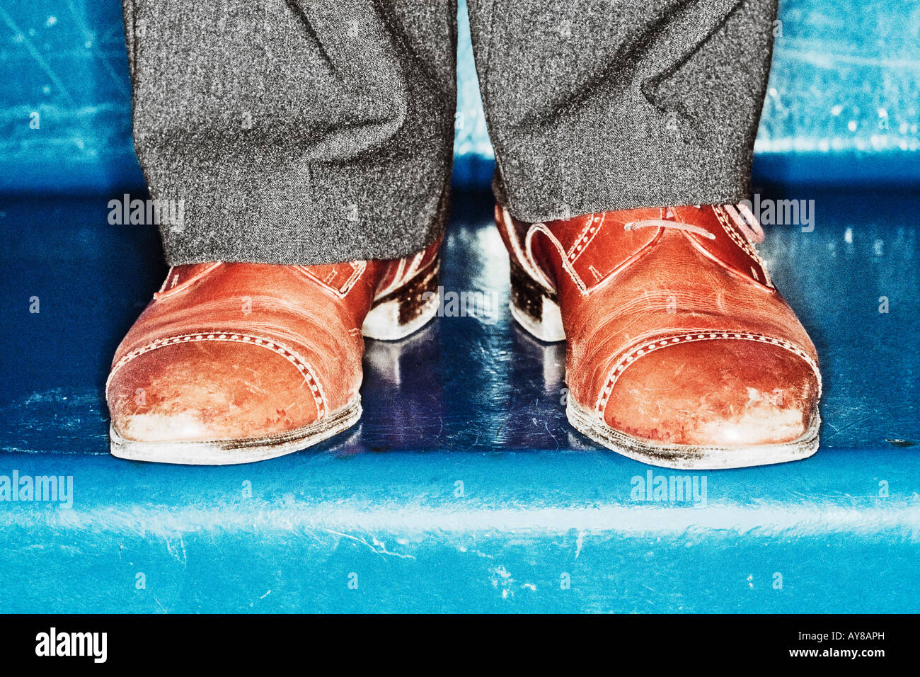 Shoes Of Unrecognizable Person On Blue Steps Stock Photo