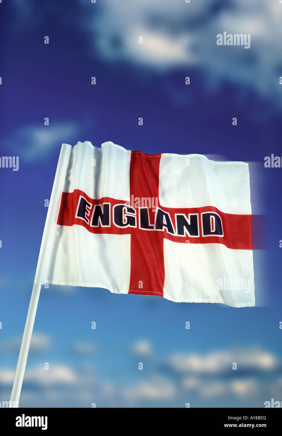 English flag of Saint George with England logo and blue sky white cloud background Stock Photo