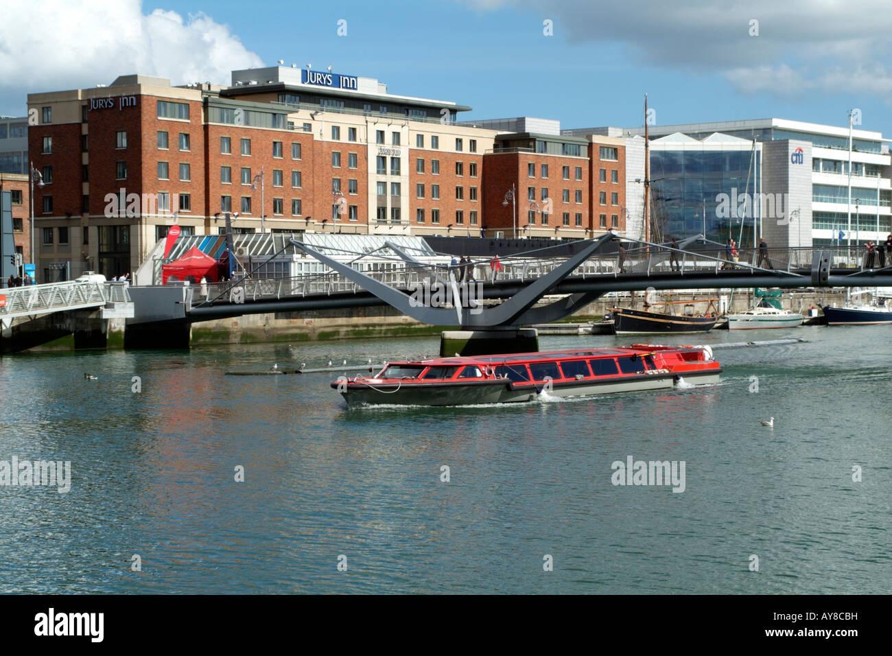 River Liffey Tourist Cruise Boat Passing Dublin City Mooring Stock Photo