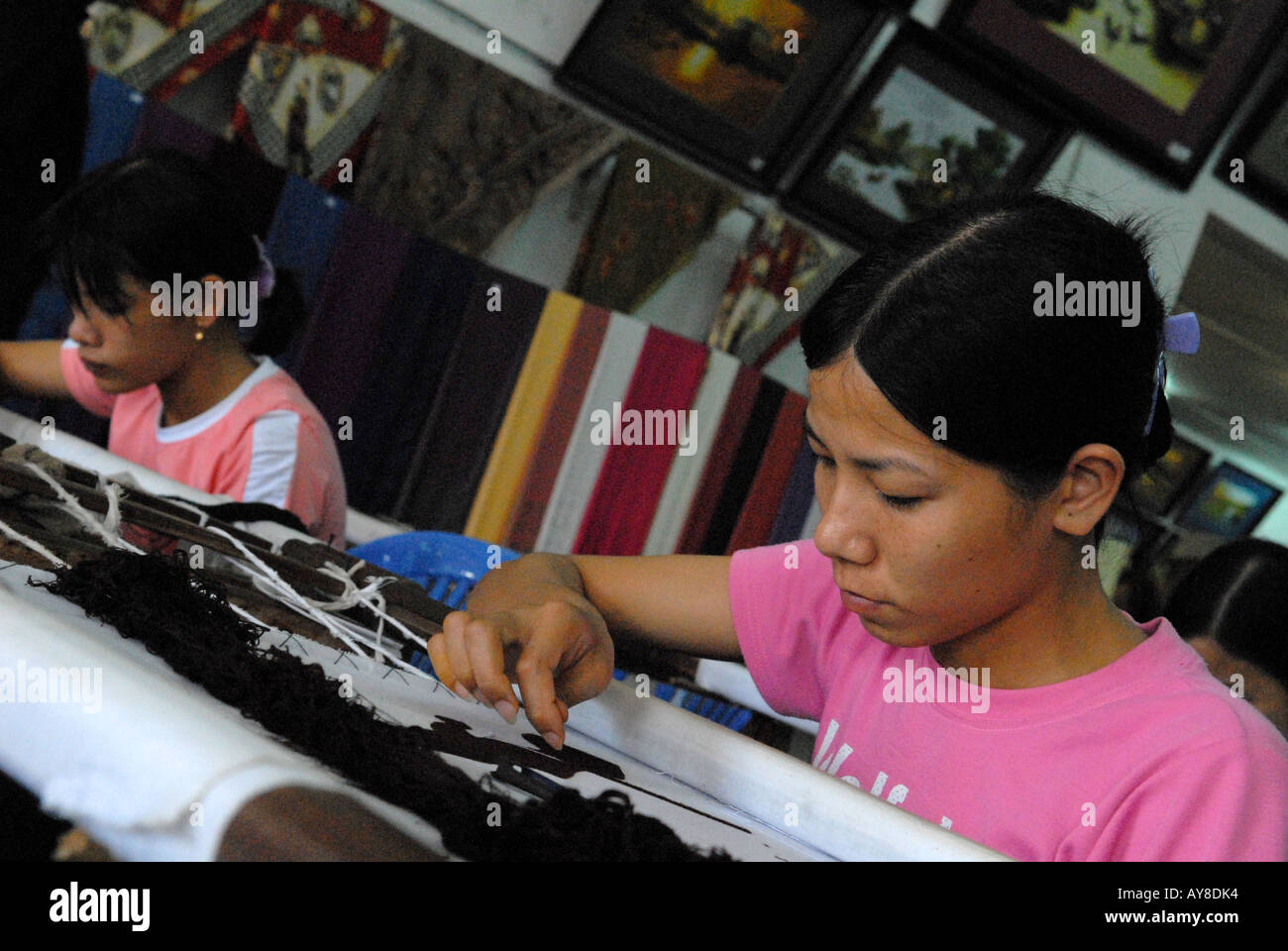 Young female workers doing embroidery Hanoi Vietnam - Stock Image