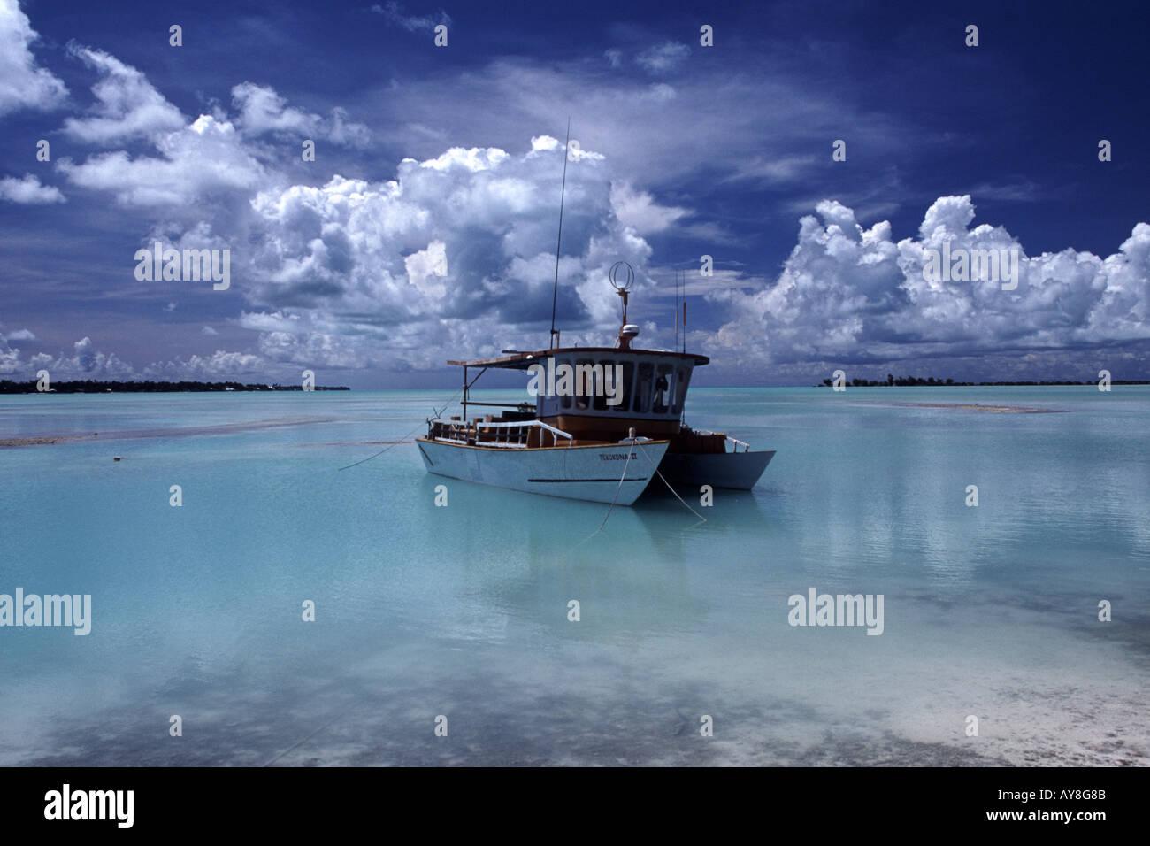 A catamaran water taxi anchored just off the beach Tarawa Kiribati - Stock Image