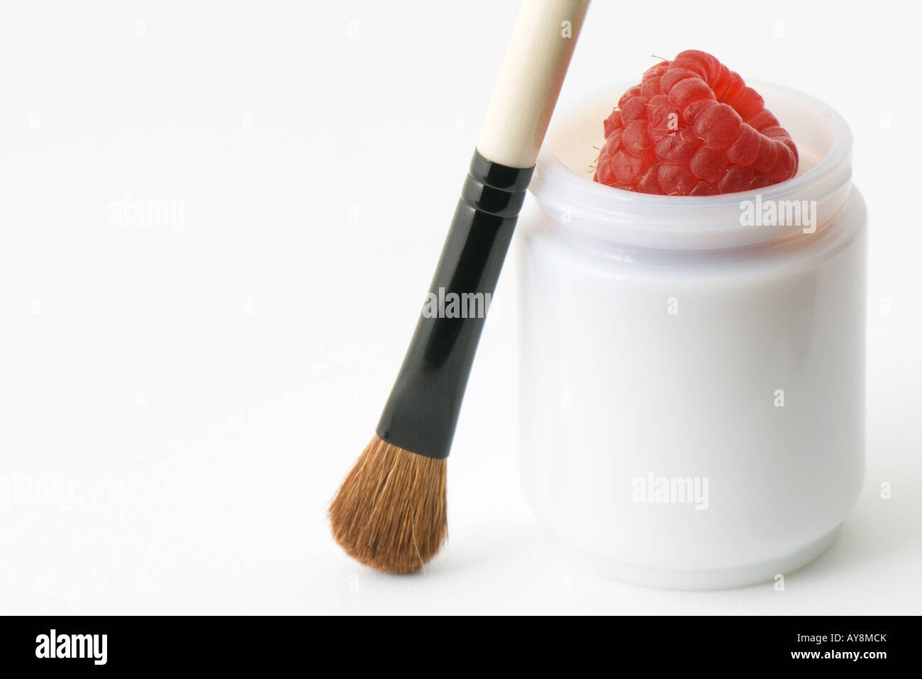 Natural cosmetics, fresh raspberry in small container, with