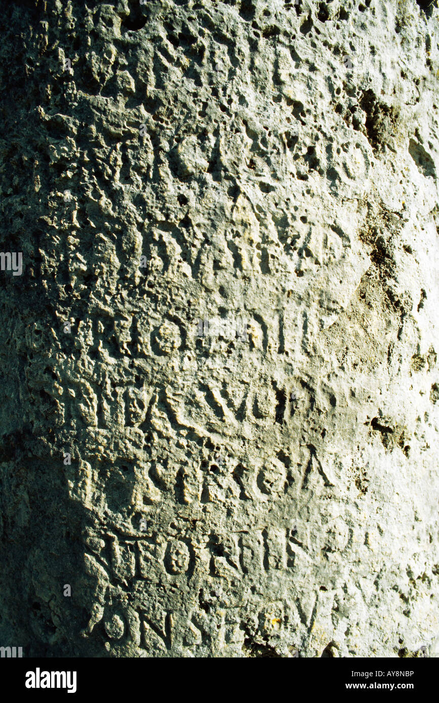 Text carved in stone, close-up, full frame - Stock Image