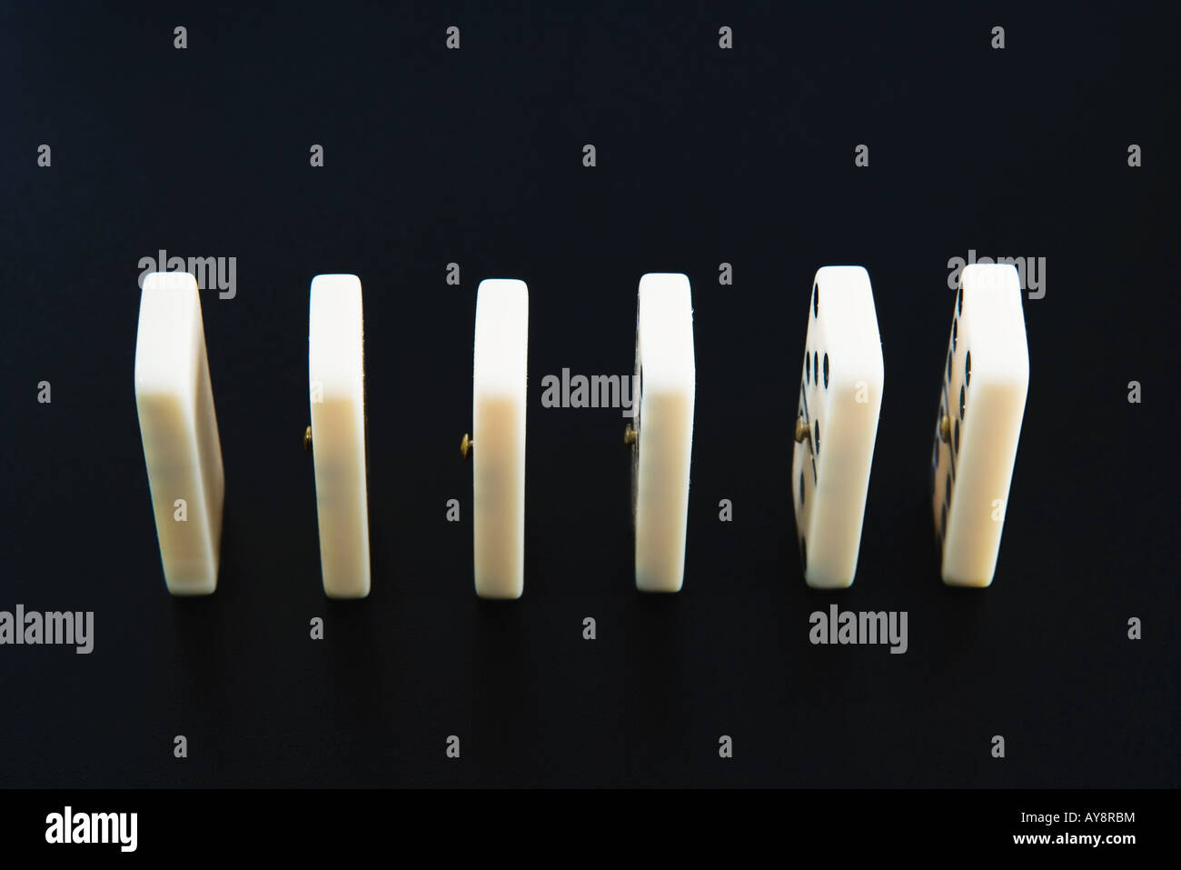 Dominoes in a row, close-up - Stock Image