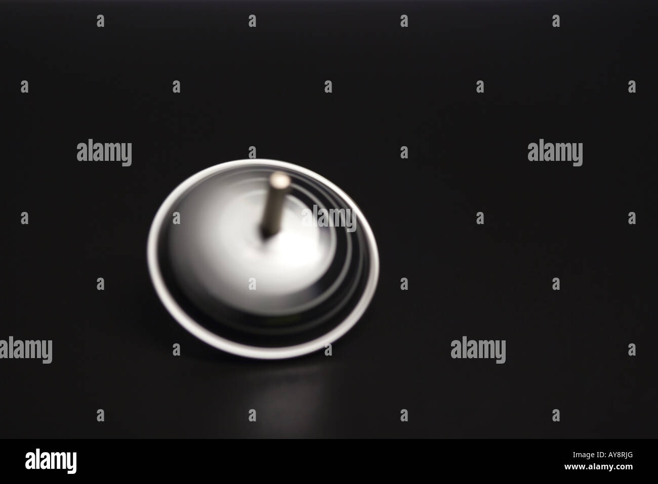 Toy top, spinning, close-up - Stock Image