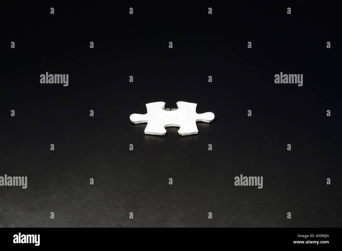 Jigsaw puzzle piece, close-up - Stock Image