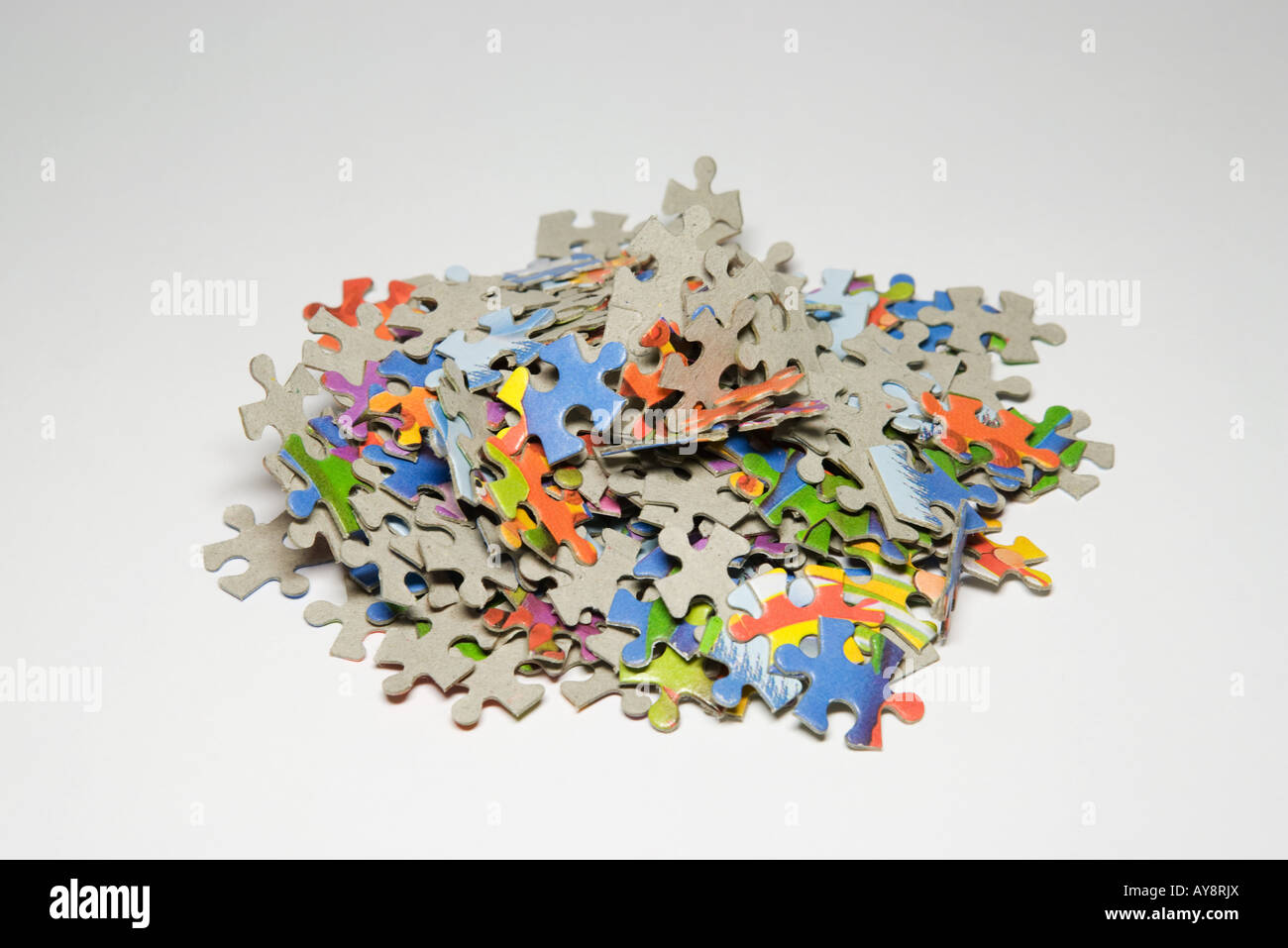 Jigsaw Puzzle Pieces In A Pile Close Up